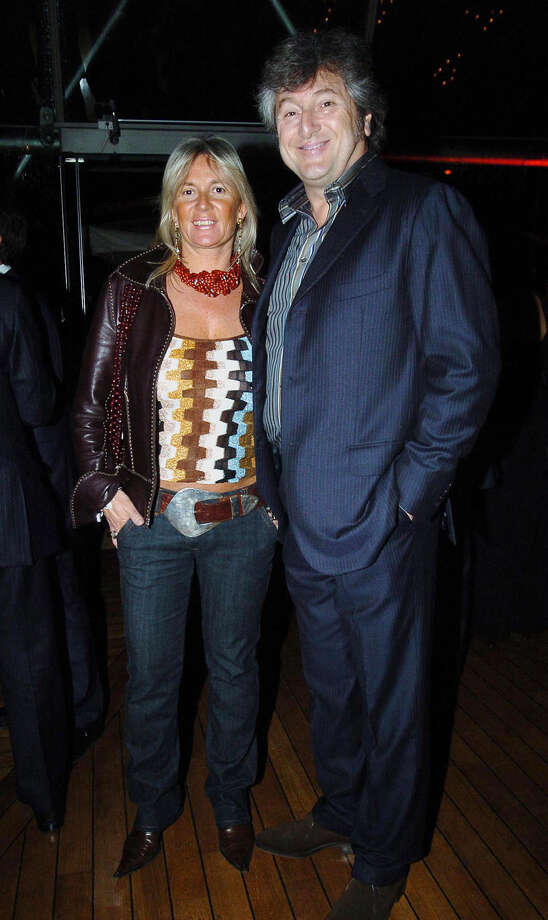 In this photo taken on March 30, 2005 Vittorio Missoni, right, and his wife Maurizia Castiglioni smile in Milan, Italy. The search resumed Saturday, Jan. 5, 2013 for a small plane that has disappeared off the Venezuelan coast with six people aboard, including Vittorio Missoni, a top executive in Italy's Missoni fashion house, officials said. Vittorio Missoni, 58, is the director general of the iconic brand and the eldest son of the company's founder. Flying with him on Friday's flight from Venezuela's Los Roques resort archipelago to Caracas, was Missoni's wife, Maurizia Castiglioni, two Italian friends of the couple, and a crew of two Venezuelans. (AP Photo/Livio Valerio, Lapresse) Photo: Livio Valerio / PRESL