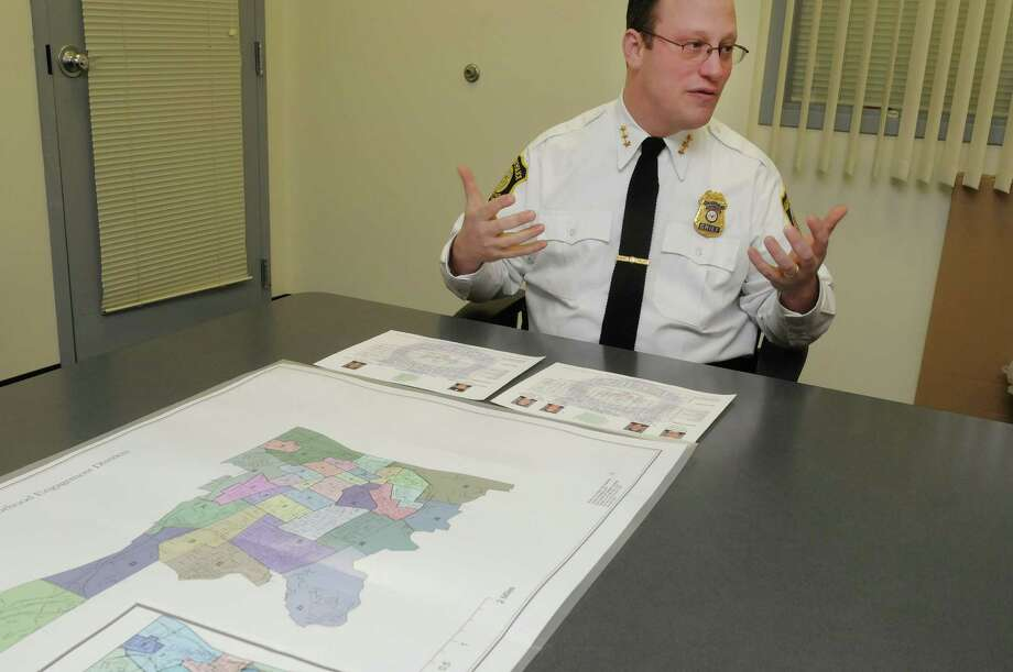 Albany Police Chief Steve Krokoff talks about crime data his department is making public during an interview at the  Albany Public Safety Building on Monday, Dec. 17, 2012 in Albany, NY.   On the table is the department's neighborhood engagement districts map.  (Paul Buckowski / Times Union) Photo: Paul Buckowski / 00020499A