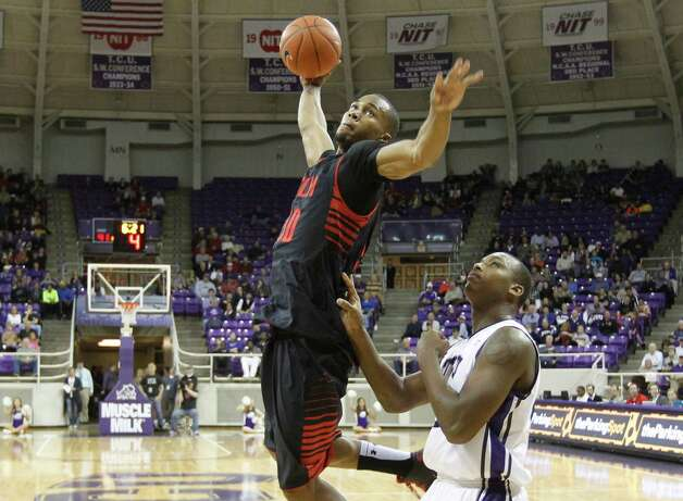 Texas Tech's Jaye Crockett (30) scores against Texas Christian University's Devonta Abron in the second half at Daniel-Meyer Coliseum in Fort Worth, Texas, Saturday, January 5, 2013. Texas Tech defeated TCU, 62-53. (Joyce Marshall/Fort Worth Star-Telegram/MCT) Photo: Joyce Marshall, McClatchy-Tribune News Service / Fort Worth Star-Telegram