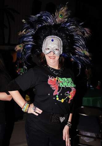 Beth Boren of Nederland shows off her festive mask at the Beans and Jeans party at the Carl A. Parker Center on the Lamar State College Port Arthur campus on Saturday, January 5, 2013.  The Beans and Jeans party is a brand new Mardi Gras Southeast Texas event that is hosted by  the Krewe of Krewes.  The event featured live music by Champagne Room and a Presentation of Krewes. Photo taken: Randy Edwards/The Enterprise