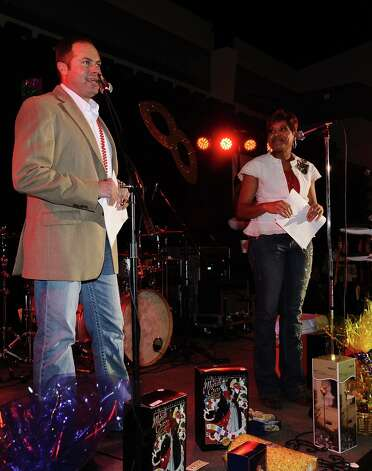 James Ware and Jackie Simien are crowned King and Queen by the Krewe of Krewes at the Beans and Jeans party at the Carl A. Parker Center on the Lamar State College Port Arthur campus on Saturday, January 5, 2013.  The Beans and Jeans party is a brand new Mardi Gras Southeast Texas event that is hosted by  the Krewe of Krewes.  The event featured live music by Champagne Room and a Presentation of Krewes. Photo taken: Randy Edwards/The Enterprise Photo: Randy Edwards