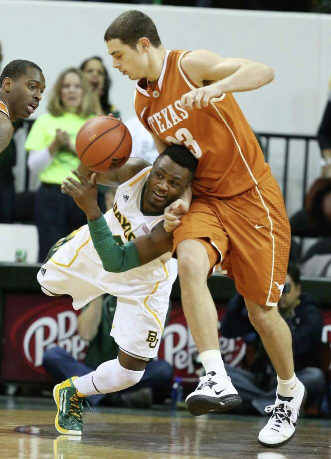 Baylor's Gary Franklin, left, is pressured by Texas' Ioannis Papapetrou as he tries to pass the ball in the second half of Saturday's game at Waco. Photo: Rod Aydelotte, MBO / Waco Tribune Herald