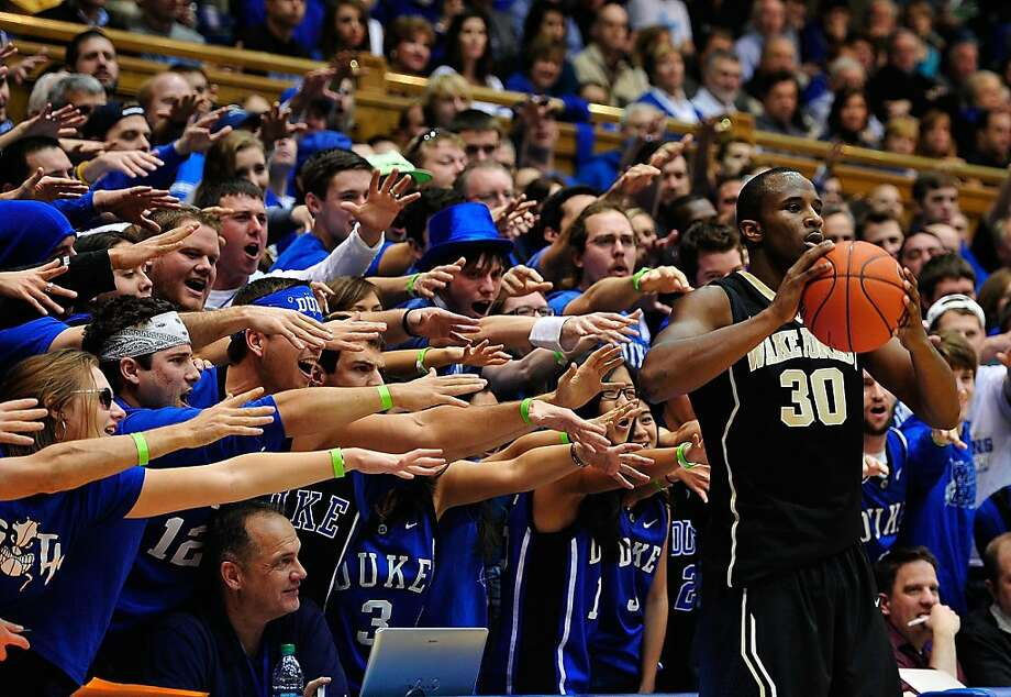 Duke Blue Devils fans taunt Travis McKie #30 of the Wake Forest Demon Deacons as he prepares to inbound the ball during play at Cameron Indoor Stadium on January 5, 2013 in Durham, North Carolina. Photo: Grant Halverson, Getty Images