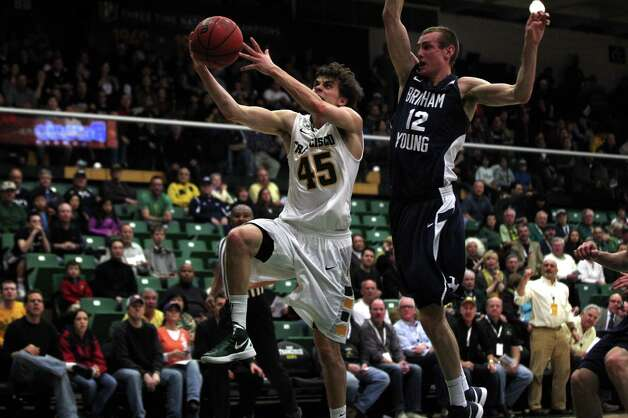 USF guard Cody Doolin, who had 22 points, scores in front of BYU forward Josh Sharp in the first half at Memorial Gym. Photo: Lance Iversen, The Chronicle