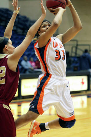 Roadrunner forward Mannasha Bell flies in for a close range shot against Alison Janecek in the second half as UTSA plays Denver in women's basketball at the UTSA Convocation Center on January 5, 2013. Photo: Tom Reel, Express-News / ©2012 San Antono Express-News