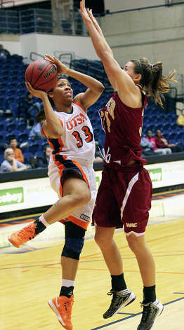 Roadrunner forward Mannasha Bell soars to the hoop against Theresa Wirth as UTSA plays Denver in women's basketball at the UTSA Convocation Center on January 5, 2013. Photo: Tom Reel, Express-News / ©2012 San Antono Express-News