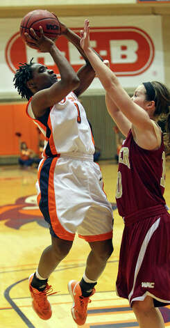 Roadrunner guard Miki Turner cranks up a shot against Morgan Van Riper Rose as UTSA plays Denver in women's basketball at the UTSA Convocation Center on January 5, 2013. Photo: Tom Reel, Express-News / ©2012 San Antono Express-News