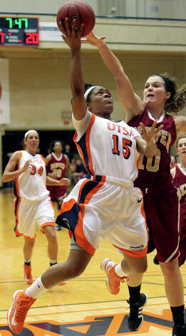 Roadrunner guard Simone Young tries a shot against Morgan Van Riper Rose as UTSA plays Denver in women's basketball at the UTSA Convocation Center on January 5, 2013. Photo: Tom Reel, Express-News / ©2012 San Antono Express-News