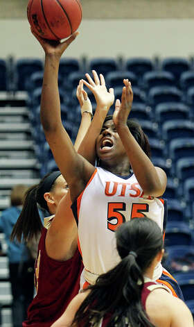 Roadrunners forward Cori Cooper puts up a shot against Alison Janecek as UTSA plays Denver in women's basketball at the UTSA Convocation Center on January 5, 2013. Photo: Tom Reel, Express-News / ©2012 San Antono Express-News