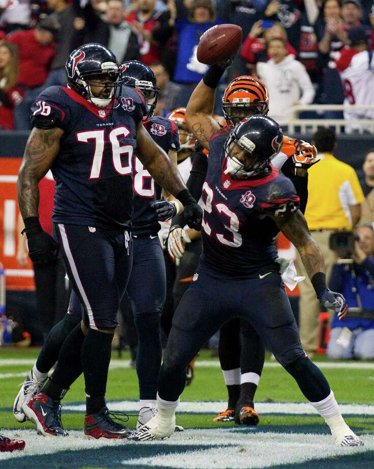 Running back Arian Foster (23) puts an exclamation point on his third-quarter touchdown run, which gave the Texans a two-score lead. Photo: Brett Coomer, Staff / © 2013  Houston Chronicle