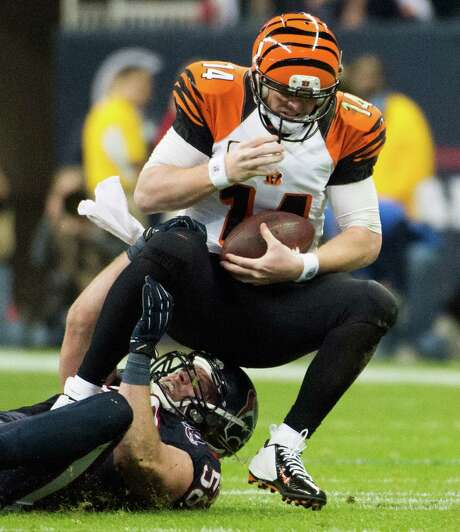 The Bengals' Andy Dalton, top, hasn't thrown a TD pass in three games against Brooks Reed and the Texans. Photo: Smiley N. Pool, Staff / © 2013  Houston Chronicle