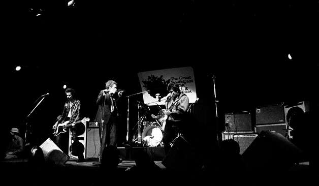 The British punk rock band Sex Pistols debut in the United States with a performance in Atlanta, Ga., Jan. 5, 1978.  At center stage is the band's frontman Johnny Rotten as he sips refreshment during the show.  From left are, Sid Vicious, bass player; Paul Cook, drums; and Steve Jones, guitar. Photo: Associated Press File Photo