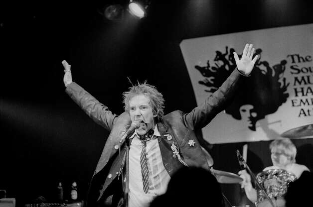 Johnny Rotten, leader of the English punk band the Sex Pistols gestures during their debut in the United States, in Atlanta, Ga., Jan. 6, 1978. Memphis, Tenn., is the next stop for the band. In the background is drummer Paul Cook. Photo: Joe Holloway Jr., Associated Press File Photo