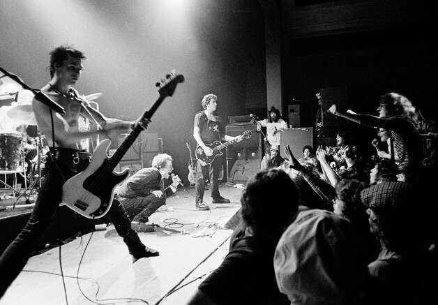 "English punk rock group ""Sex Pistols"" get a form of audience participation on January 7, 1978 in Memphis, Tenn., during the second stop of their American tour. In left foreground is bass player Sid Vicious while group leader Johnny Rotten crouches in foreground. Photo: Associated Press File Photo"