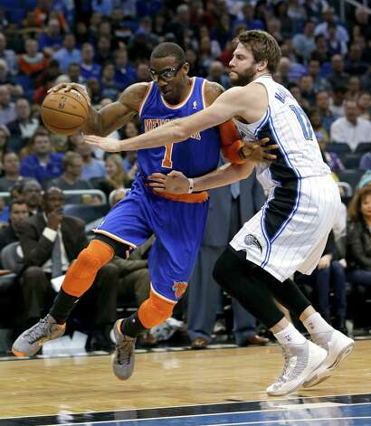 New York Knicks' Amare Stoudemire, left, drives around Orlando Magic's Josh McRoberts during the first half of an NBA basketball game, Saturday, Jan. 5, 2013, in Orlando, Fla. (AP Photo/John Raoux) Photo: John Raoux