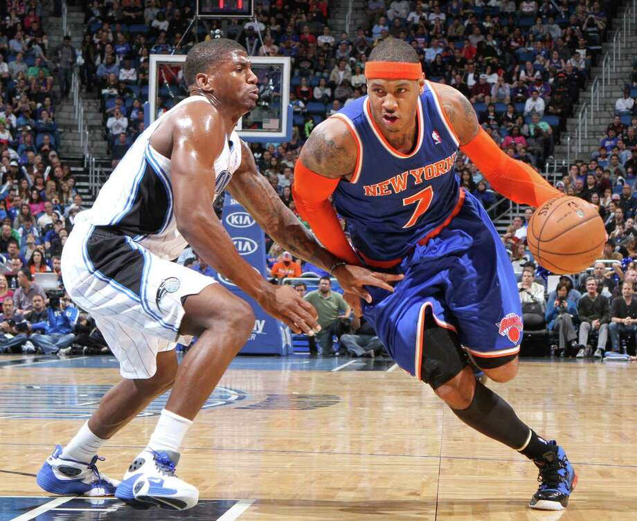 New York Knicks forward Carmelo Anthony (7) drives against Orlando Magic forward DeQuan Jones (20) during the second half at the Amway Center in Orlando, Florida, Saturday, January 5, 2013. The Knicks defeated the Magic, 114-106. (Gary W. Green/Orlando Sentinel/MCT) Photo: Gary W. Green, MBR / Orlando Sentinel