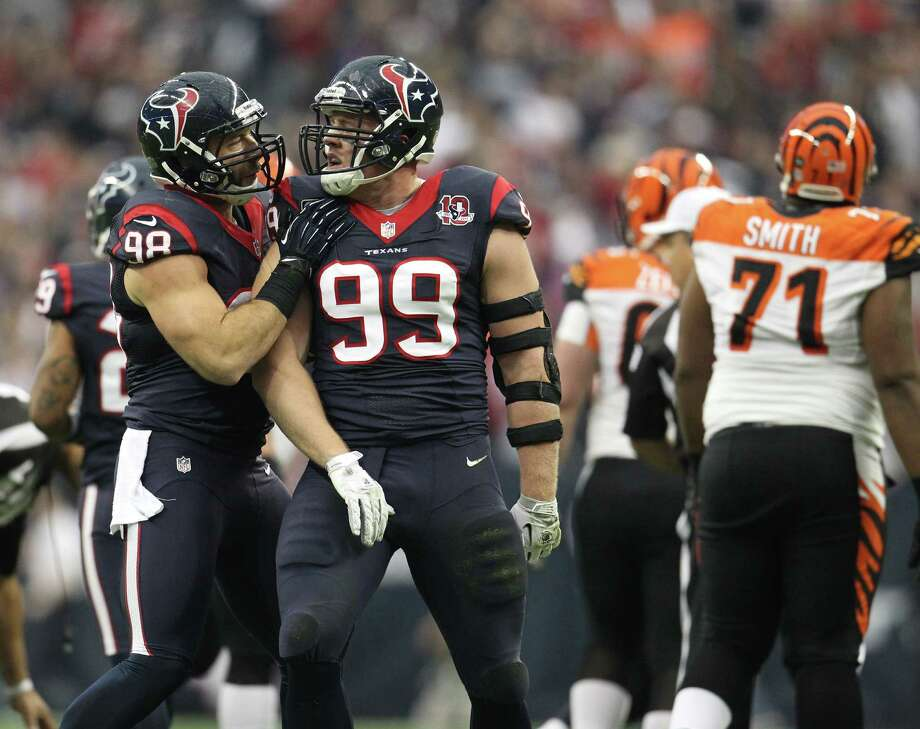 Texans defensive end J.J. Watt (99) had another big day, including a sack of the Bengals' Andy Dalton that he celebrated with Connor Barwin in the first quarter. Photo: Karen Warren, Staff / © 2012 Houston Chronicle