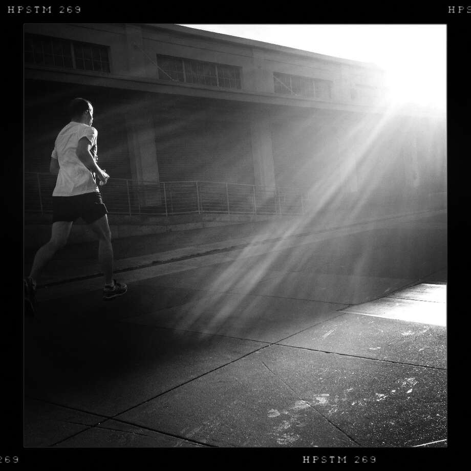 A runner heads towards the light on the Embarcadero on the last day of 2012. Photo: Mike Kepka, The Chronicle / ONLINE_YES