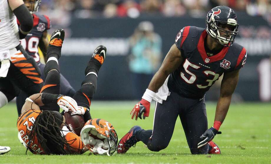 Linebacker Bradie James, right, and the Texans might have regained momentum after a win over running back BenJarvus Green-Ellis and the Bengals, but the Patriots are expected to be a bigger challenge. Photo: Karen Warren, Staff / © 2012 Houston Chronicle