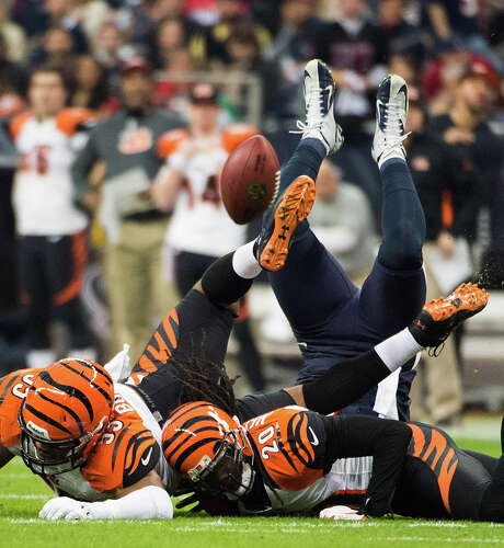Bengals strong safety Chris Crocker, left, and free safety Reggie Nelson crash to the ground after knocking a pass away from Texans tight end Owen Daniels. Photo: Smiley N. Pool, Staff / © 2013  Houston Chronicle
