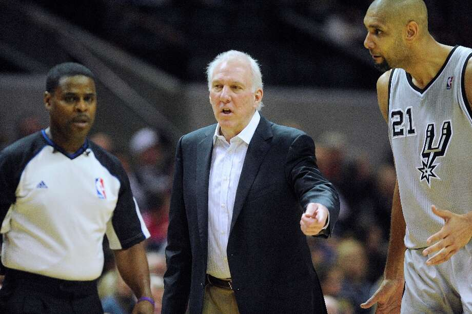 Spurs coach Gregg Popovich (middle) and player Tim Duncan (right) speak with official Leroy Richardson after a foul was called on Duncan in the AT&T Center on Saturday, Jan. 5, 2013. Photo: Billy Calzada, San Antonio Express-News / SAN ANTONIO EXPRESS-NEWS