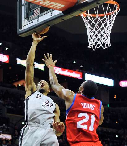 Kawhi Leonard of the Spurs shoots over Thaddeus Young of the Philadelphia 76ers in the AT&T Center on Saturday, Jan. 5, 2013. Photo: Billy Calzada, San Antonio Express-News / SAN ANTONIO EXPRESS-NEWS