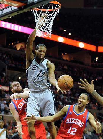 Kwahi Leonard (2) of the Spurs battles Spencer Hawes (00) and Evan Turner (12) of the Philadelphia 76ers for the ball during second-half action in the AT&T Center on Saturday, Jan. 5, 2013. Photo: Billy Calzada, San Antonio Express-News / SAN ANTONIO EXPRESS-NEWS