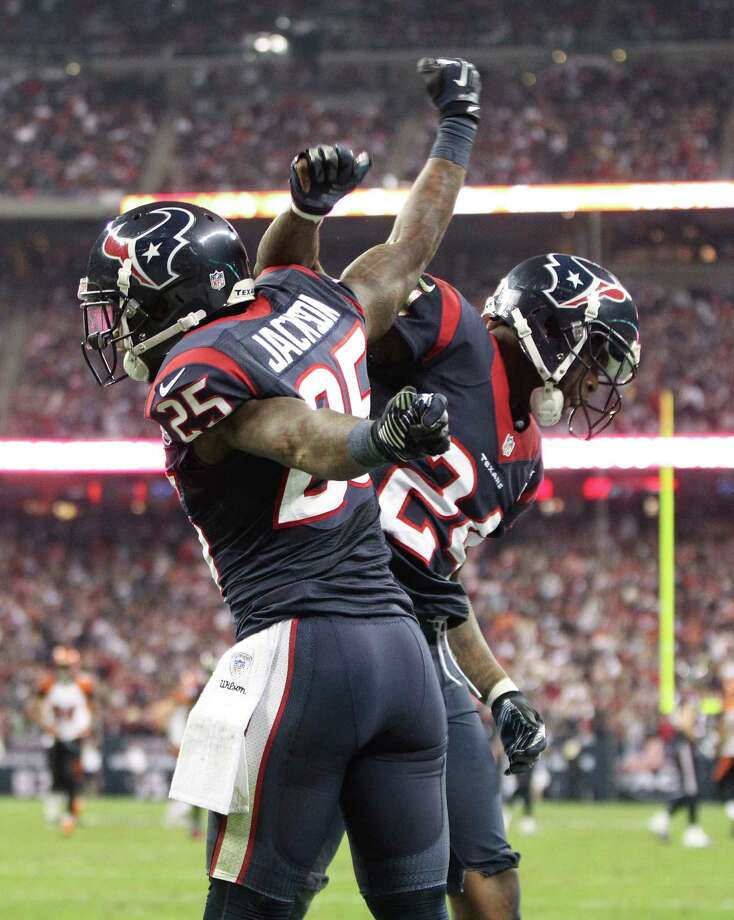 Texans cornerbacks Johnathan Joseph (24) and Kareem Jackson (25) celebrate after breaking up a pass in the end zone during the fourth quarter. Photo: Karen Warren, Houston Chronicle / © 2012 Houston Chronicle