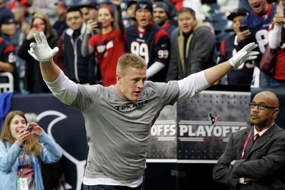 Texans defensive end J.J. Watt  greets the crowd after warming up. Photo: Karen Warren, Houston Chronicle / © 2012 Houston Chronicle