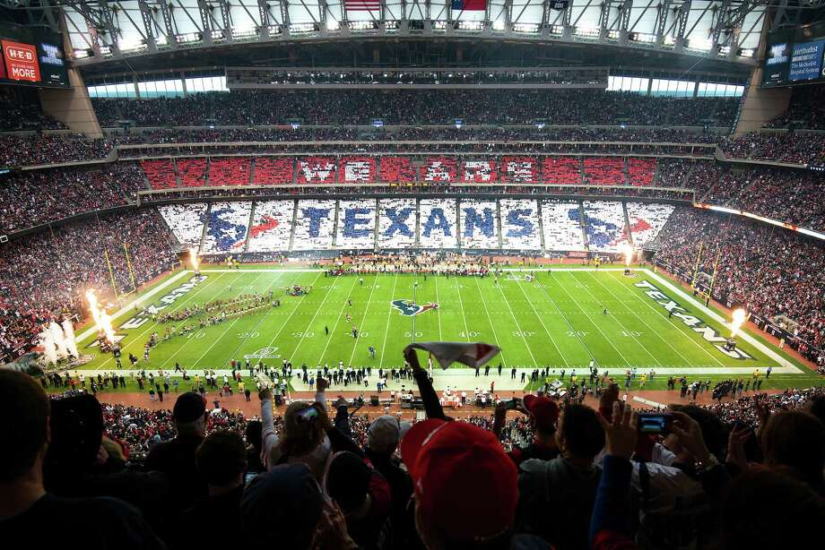 "Texans fans perform a card stunt spelling out ""We Are Texans"" as their team takes the field. Photo: Smiley N. Pool, Houston Chronicle / © 2013  Houston Chronicle"