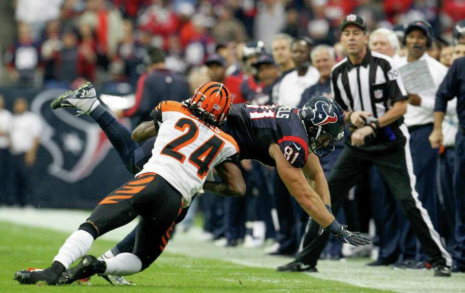 Texans tight end Owen Daniels (81) is brought down by Bengals cornerback Adam Jones (24)  as he fails to catch a pass during the second quarter. Photo: Karen Warren, Houston Chronicle / © 2012 Houston Chronicle