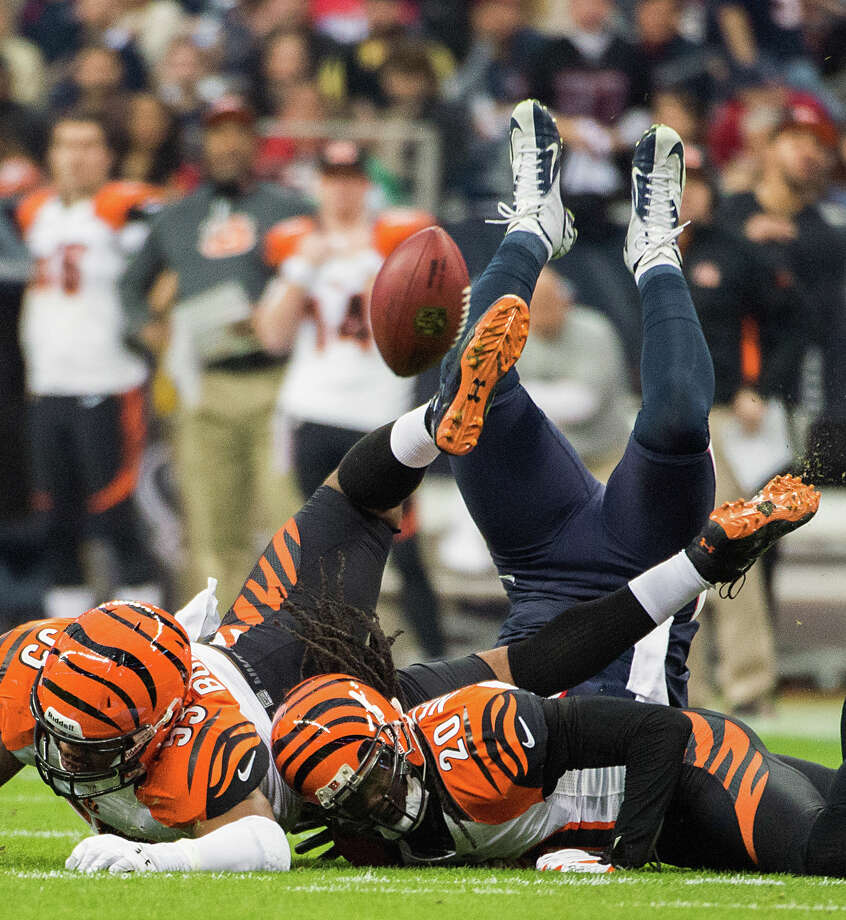 Bengals strong safety Chris Crocker (33) and free safety Reggie Nelson (20) knock a pass away from Texans tight end Owen Daniels (81) during the first half. Photo: Smiley N. Pool, Houston Chronicle / © 2013  Houston Chronicle