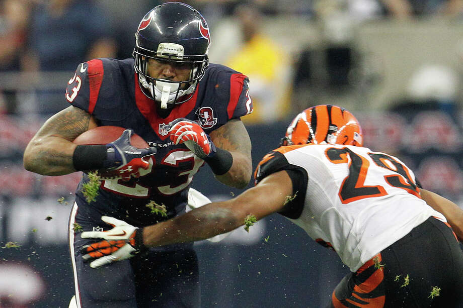 Texans running back Arian Foster (23) tries to get past Bengals cornerback Leon Hall (29) during the third quarter. Photo: Karen Warren, Houston Chronicle / © 2012 Houston Chronicle
