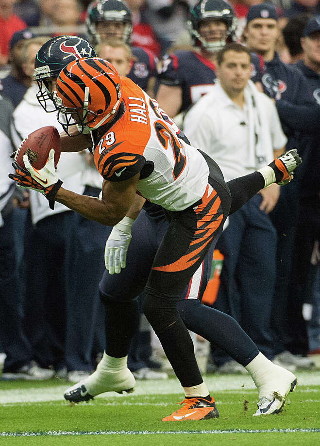 Bengals cornerback Leon Hall (29) intercepts a pass intended for Texans tight end Garrett Graham (88) and returns it 21-yards for a touchdown during the second quarter. Photo: Smiley N. Pool, Houston Chronicle / © 2013  Houston Chronicle