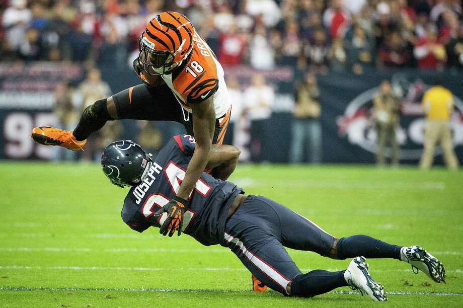 Texans cornerback Johnathan Joseph (24) makes a stop on Bengals wide receiver A.J. Green (18) during the third quarter. Photo: Smiley N. Pool, Houston Chronicle / © 2013  Houston Chronicle