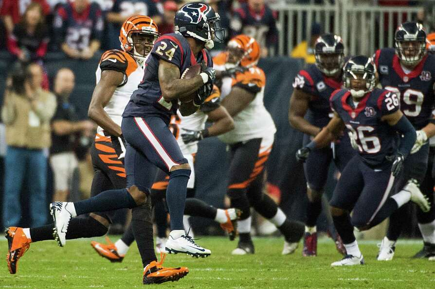Texans cornerback Johnathan Joseph (24) intercepts a pass intended for Bengals wide receiver A.J. Gr