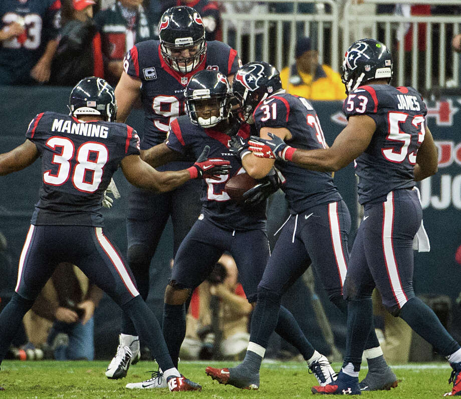 Texans cornerback Johnathan Joseph (24) celebrates with teammates after intercepting a pass during the second half. Photo: Smiley N. Pool, Houston Chronicle / © 2013  Houston Chronicle