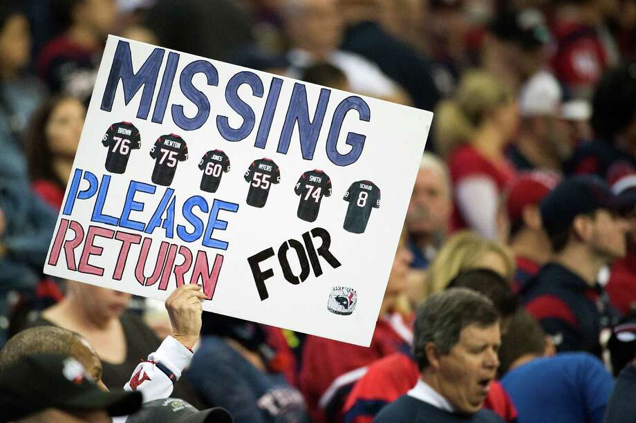 "A fan holds up a sign pleading for the ""return"" of Texans tackle Duane Brown (76), tackle Derek Newton (75), guard Ben Jones (60), guard Wade Smith (74) and quarterback Matt Schaub (8) for a Super Bowl ring. Photo: Smiley N. Pool, Houston Chronicle / © 2013  Houston Chronicle"