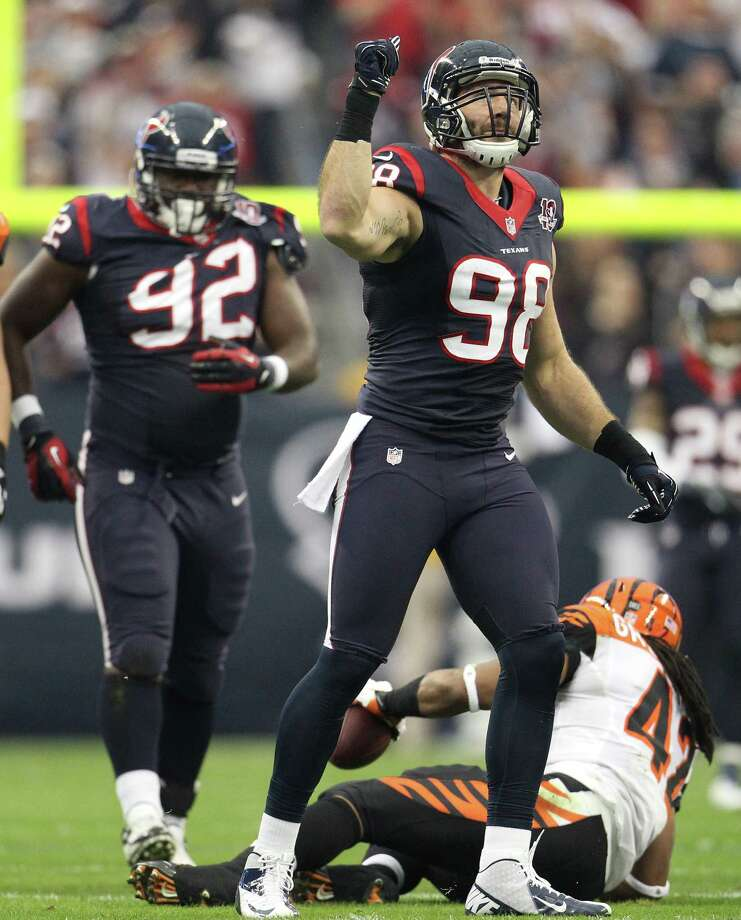 Texans outside linebacker Connor Barwin (98) celebrates stopping Bengals running back BenJarvus Green-Ellis (42) during the first quarter. Photo: Karen Warren, Houston Chronicle / © 2012 Houston Chronicle