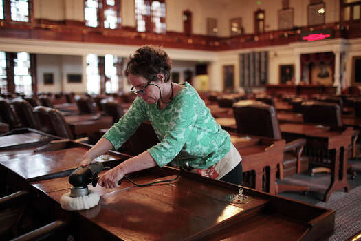 Contract worker Mara Eurich, (cq), reconditions desks in the Texas House of Representative Chambers at the State Capitol in Austin, Thursday, Jan. 2, 2013.  The Texas 83rd Legislature will convene on Tuesday, Jan. 8. Photo: Jerry Lara, San Antonio Express-News / © 2012 San Antonio Express-News