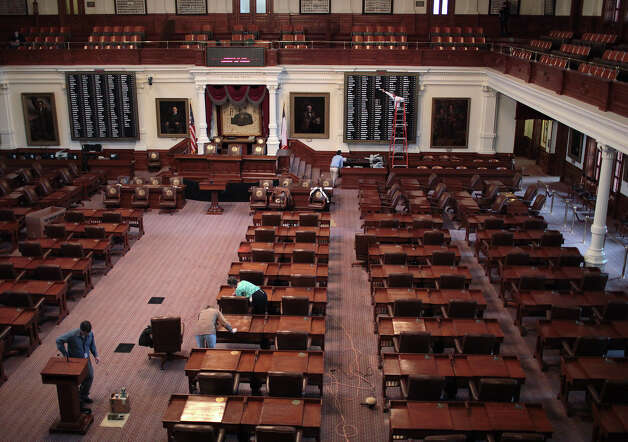 Workers prepare the Texas House of Representatives Chambers at the State Capitol in Austin, Thursday, Jan. 2, 2013. The Texas 83rd Legislature will convene on Tuesday, Jan. 8. Photo: Jerry Lara, San Antonio Express-News / © 2012 San Antonio Express-News