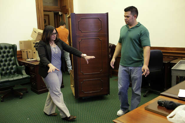 Donna Campbell's Senior Legislative Aide Tanya Vazquez (cq), provides instructions as furniture arrives at the senatorÕs offices at the State Capitol in Austin, Thursday, Jan. 2, 2013. The Texas 83rd Legislature will convene on Tuesday, Jan. 8. Campbell pulled an upset victory over senior Republican Sen. Jeff Wentworth in the District 25 runoff election this past July and went on to beat Democratic candidate John Courage in the November 6 general election. Helping move the furniture are Kevin Longoria, right, and Cody Wier, (cq), center. Photo: Jerry Lara, San Antonio Express-News / © 2012 San Antonio Express-News