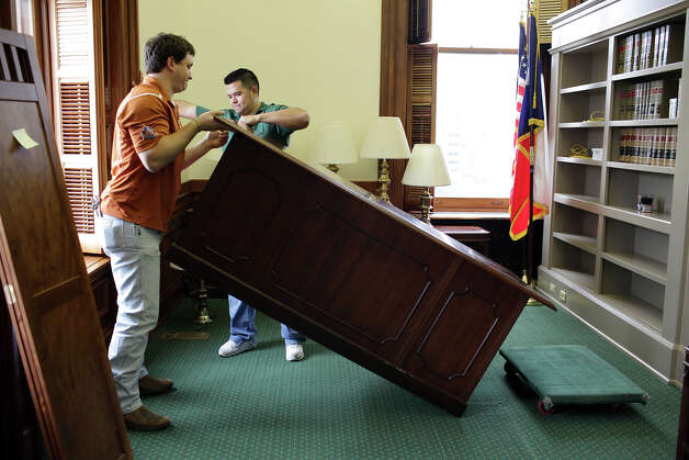 Cody Wier, (cq), left, and Kevin Longoria place a desk inside Donna Campbell's office at the State Capitol in Austin, Thursday, Jan. 2, 2013. The Texas 83rd Legislature will convene on Tuesday, Jan. 8. Campbell pulled an upset victory over senior Republican Sen. Jeff Wentworth in the District 25 runoff election this past July and went on to beat Democratic candidate John Courage in the November 6 general election. Photo: Jerry Lara, San Antonio Express-News / © 2012 San Antonio Express-News