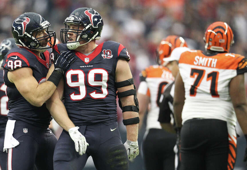 Texans defensive end J.J. Watt (99) celebrates with  linebacker Connor Barwin (98) after sacking  Be