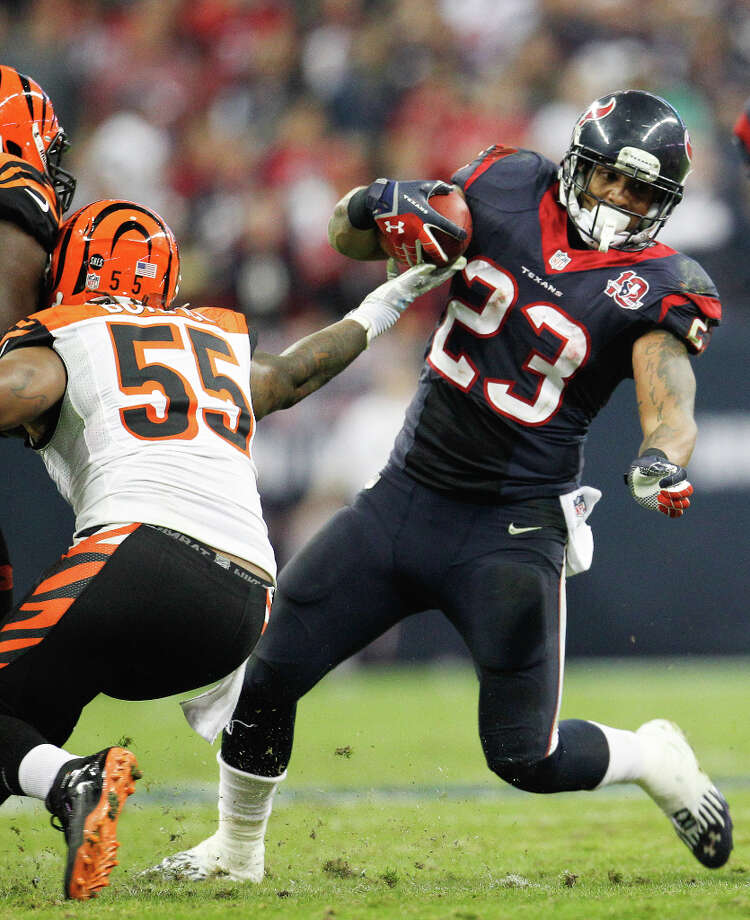 Texans running back Arian Foster (23) gains yardage against Bengals linebacker Vontaze Burfict (55) during the third quarter. Photo: Karen Warren, Houston Chronicle / © 2012 Houston Chronicle