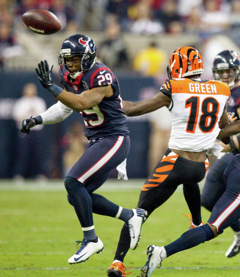 Houston Texans strong safety Glover Quin (29) breaks up a pass intended for Cincinnati Bengals wide receiver A.J. Green (18) during the fourth quarter of an AFC playoff game at Reliant Stadium on Saturday, Jan. 5, 2013, in Houston. Photo: Brett Coomer, Houston Chronicle / © 2013  Houston Chronicle
