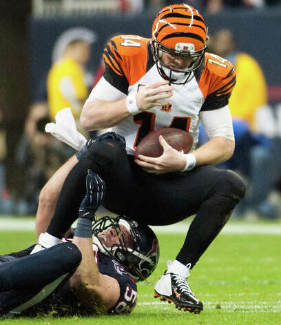 Texans linebacker Brooks Reed (58) sacks Bengals quarterback Andy Dalton (14) during the second half. Photo: Smiley N. Pool, Houston Chronicle / © 2013  Houston Chronicle
