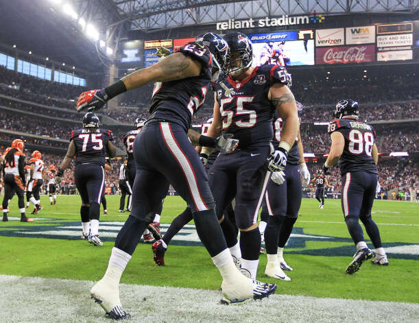 Texans running back Arian Foster (23) celebrates a 1-yard touchdown run with center Chris Myers (55) during the third quarter. Photo: Karen Warren, Houston Chronicle / © 2012 Houston Chronicle