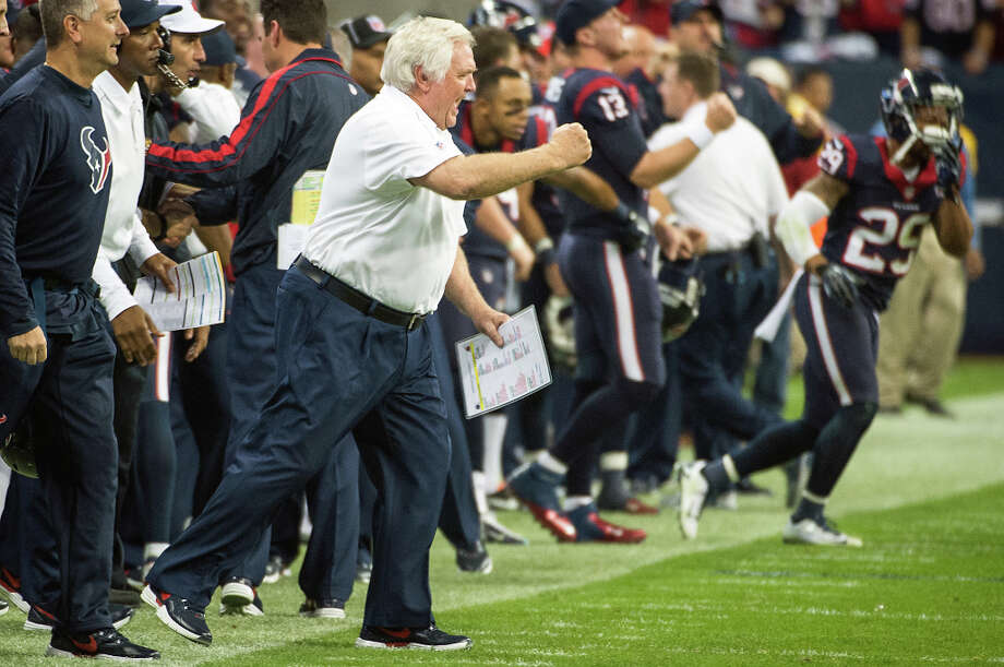 Texans defensive coordinator Wade Phillips celebrates as time expires on a 19-13 victory over the Bengals. Photo: Smiley N. Pool, Houston Chronicle / © 2013  Houston Chronicle