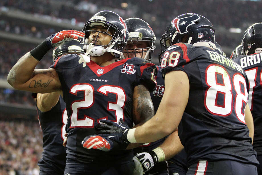 Texans running back Arian Foster celebrates his 1-yard touchdown during the third quarter. Photo: Karen Warren, Houston Chronicle / © 2012 Houston Chronicle